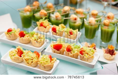 Various snacks on glass platter, banquet food