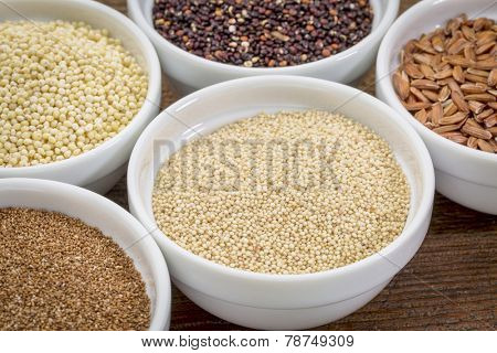 amaranth  and other gluten free grains (teff, millet, quinoa, brown rice)  in small ceramic bowls