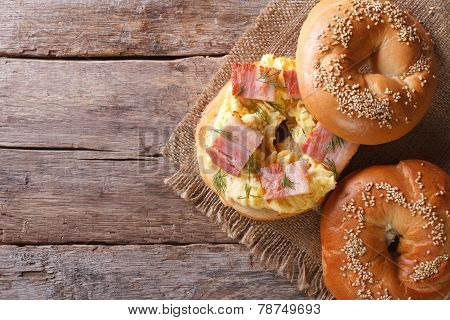Bagel With Egg And Bacon Close-up. Horizontal View From Above