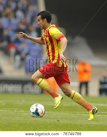 BARCELONA - MARCH, 29: Pedro Rodriguez of FC Barcelona in action during a Spanish League match against RCD Espanyol at the Estadi Cornella on March 29, 2014 in Barcelona, Spain
