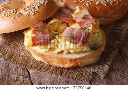Bagel With Scrambled Eggs And Bacon Close-up Horizontal
