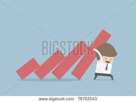 Businessman Trying To Stop Falling Graph