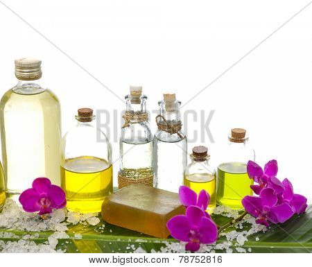 spa supplies with orchid, oil, ,soap ,salt on banana leaf