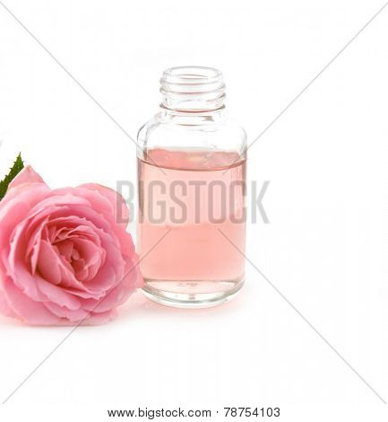 rose with massage oil on white background