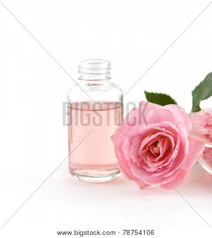 SPA �¢�?�? rose with massage oil,salt in bowl on white background