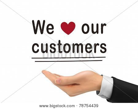 We Love Our Customers Words Holding By Realistic Hand