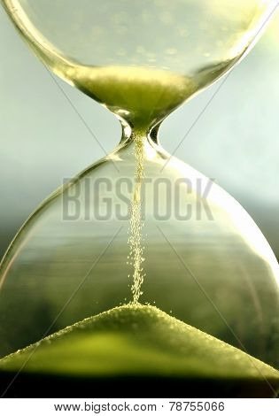 Close Up Hourglass Counting Down Time With Sand  View