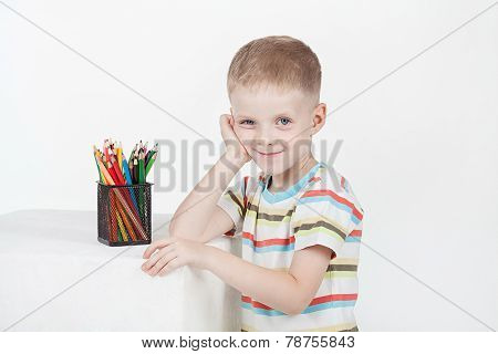 Portrait of smart lad drawing with pencils
