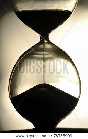 Close Up Hourglass Counting Down Time With Moving Sand  View Vintage
