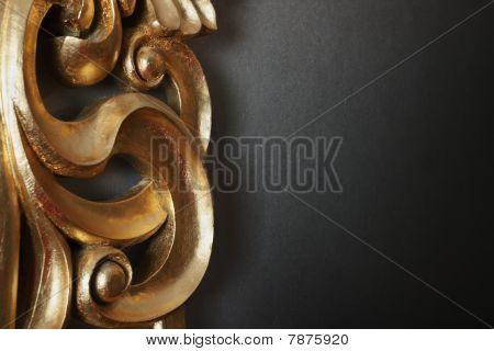 Decorative Golden Stucco Work In The Dark