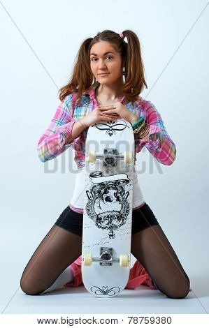 Young female posing with a skateboard