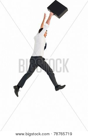 Businessman leaping with his briefcase on white background