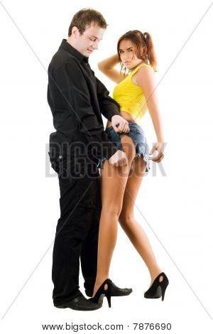 Man Rending Shorts Of Nice Woman
