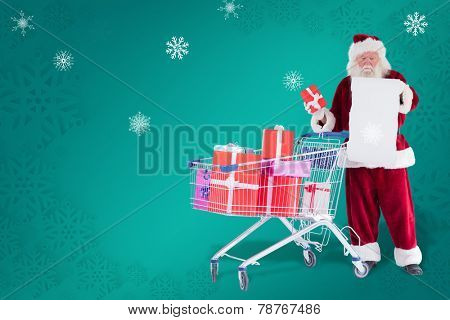 Santa spread presents with shopping cart against green snowflake background