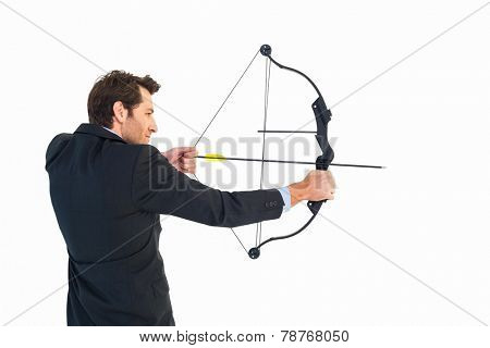 Businessman shooting bow and arrow on white background