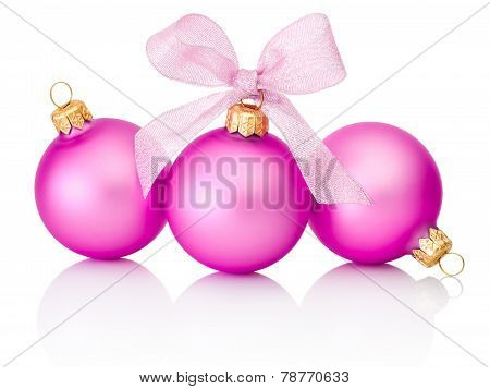 Three Pink Christmas Balls With Ribbon Bow Isolated On White Background