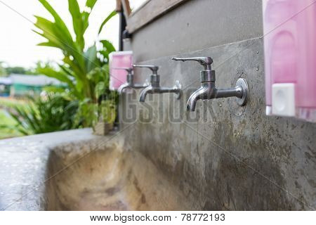 Faucet And Washbasin In Outdoor Area