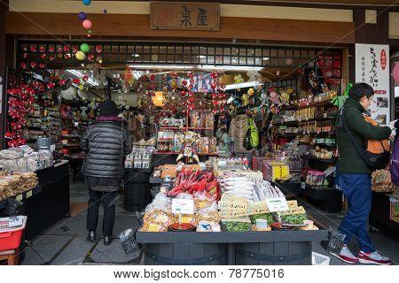 TAKAYAMA, JAPAN - DECEMBER 3, 2014: Locals shopping at the Miyagawa morning market in Takayama, Japan. This morning market sells food items, groceries to farm produce and is common in rural Japan.