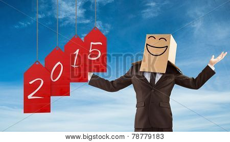 Anonymous businessman holding his hands out against blue sky