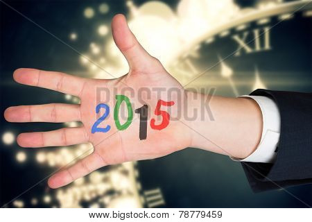 Hand with fingers spread out against black and gold new year graphic