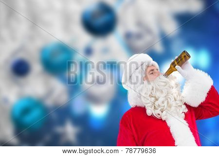 Father christmas drinking a beer against christmas decorations hanging from branch