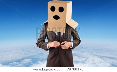 Anonymous businessman buttoning his jacket against blue sky over white clouds