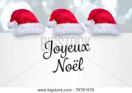 Joyeux noel against white glowing dots on grey