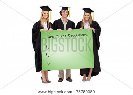 Three students in graduate robe holding a blank sign against green card
