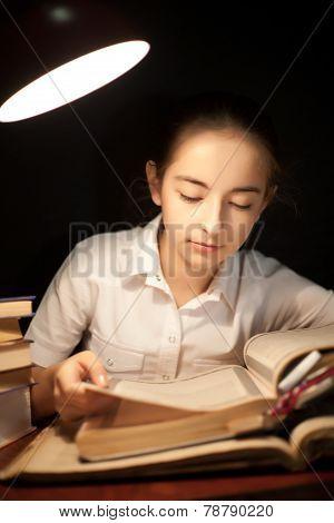 Young Girl Reading Book At Night Dark At Library