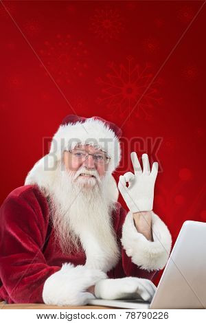 Santa is satisfied about what he found against red background