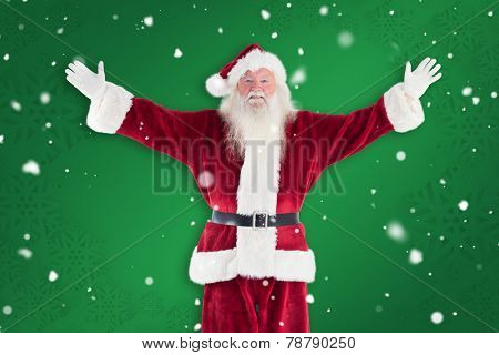 Jolly Santa opens his arms to camera against green snowflake background