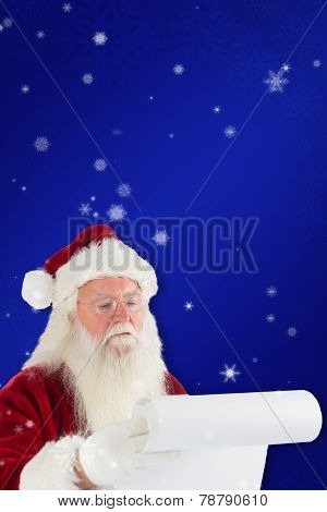 Santa claus checking his list against blue snowflake background