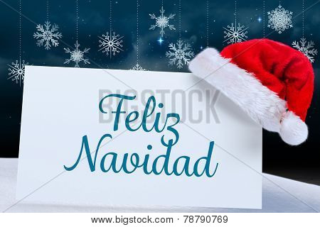 Feliz navidad against snowflake wallpaper over floor boards