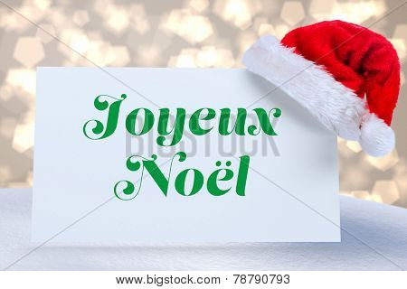 Joyeux noel against light glowing dots design pattern