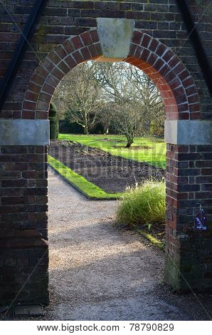 Arched brick garden entrance.
