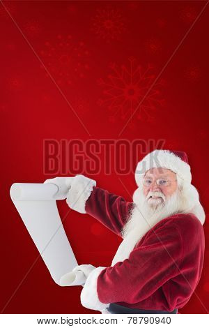 Father Christmas holds a list against red background