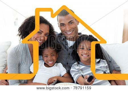 Family watching television at home against house outline