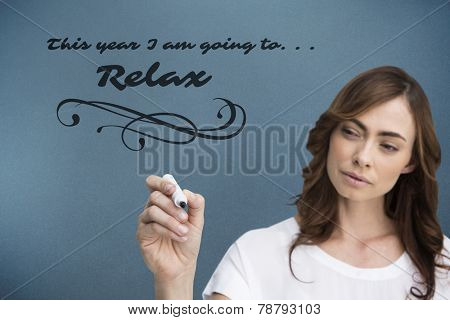 Concentrated businesswoman holding whiteboard marker against blue background with vignette