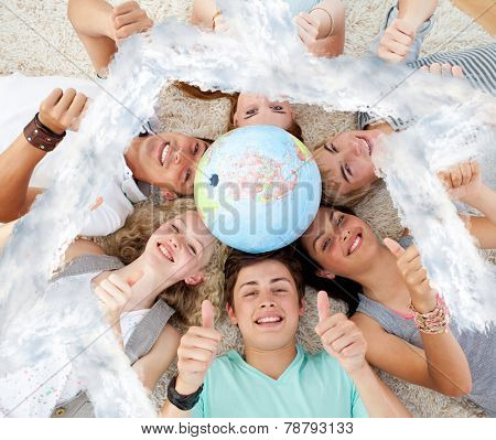 Teenagers on the floor with a terrestrial globe in the center and with thumbs up against house outline in clouds