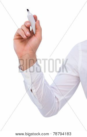 Mid section of businessman writing with marker on white background