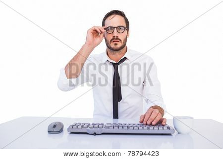 Business worker with reading glasses on computer on white background