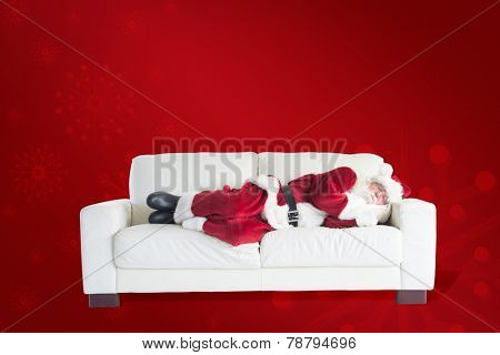 Father Christmas sleeps on a couch against red background