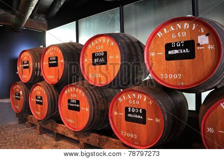 FUNCHAL, MADEIRA - OCTOBER 08, 2011: The museum - storage of expensive vintage wine Madeira. Huge barrels are marked by data of wine