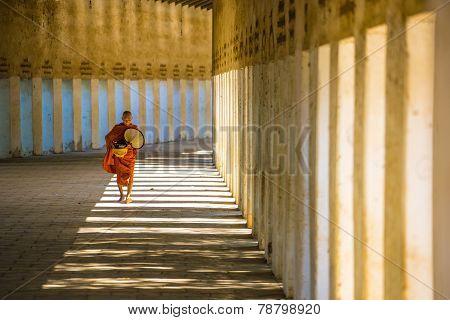 Unidentified Myanmar monk walking trough the temple at Shwezigon Pagodas