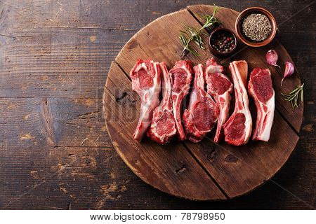 Raw Fresh Lamb Ribs With Pepper And Cumin On Wooden Cutting Board On Dark Background