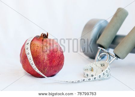 Pomegranate Fruit And Measuring Tape
