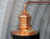 picture of copper  - Copper still apparatus for distilling moonshine alcohol - JPG