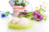 pic of paint pot  - blue campanula flowers in flower pot and easter painted eggs - JPG
