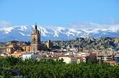 picture of snow capped mountains  - View of the town and Cathedral with the snow capped mountains of the Sierra Nevada to the rear Guadix Granada Province Andalucia Spain - JPG