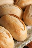 stock photo of baguette  - Petit baguettes small freshly baked French bread rolls - JPG